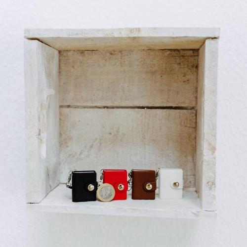 vier Mini-Fotobücher nebeneinander